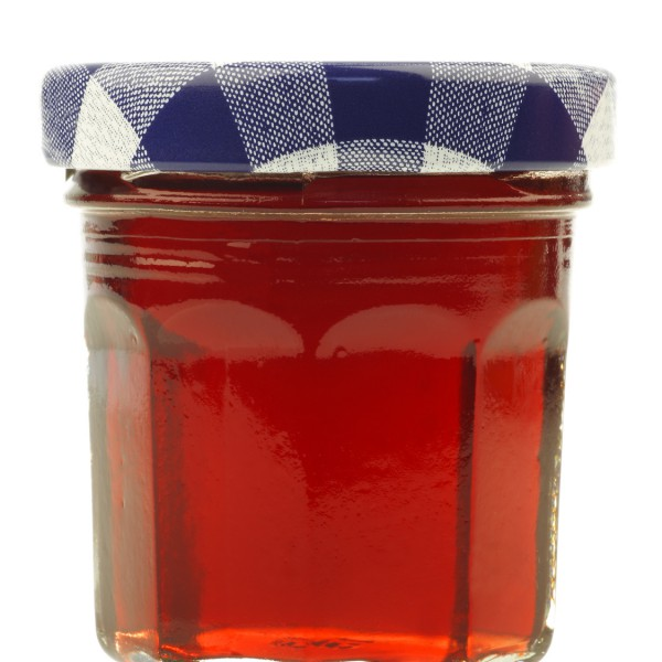 glass jar with fruit jam with room for your label, text or image